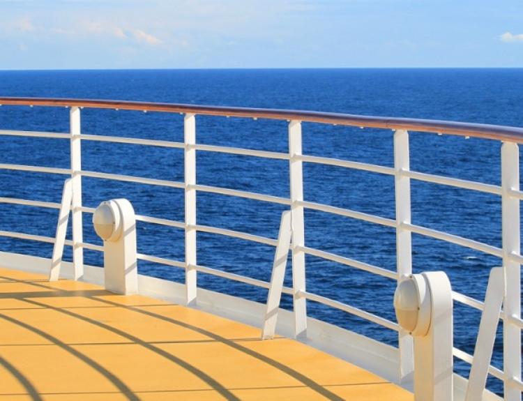 Norwegian Cruise Line Norwegian Breakaway Accommodation The Haven Deluxe Owner Suite Bedroom.jpg